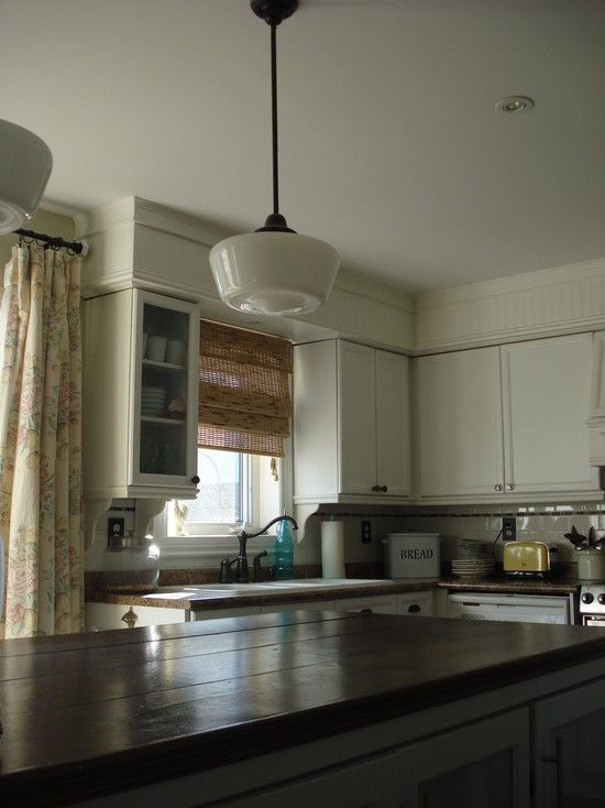 Like The Large Moulding Above The Soffits Plain Cabinets Yellow Walls Dark Counters And Ope Kitchen Soffit Above Kitchen Cabinets White Kitchen Traditional