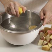 To keep potatoes from turning brown, after peeling immediately place them into acidulated water. Can be made 1 day in advance.    Fill a large bowl with enough water to cover potatoes and squeeze 2 lemons into water.