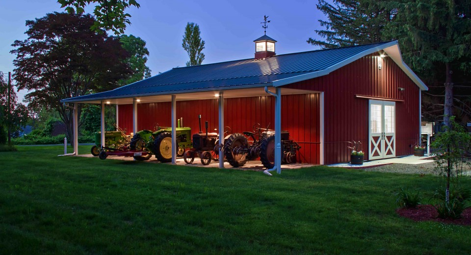 Red pole barn with porch and lighting would be great for for Metal garage with porch