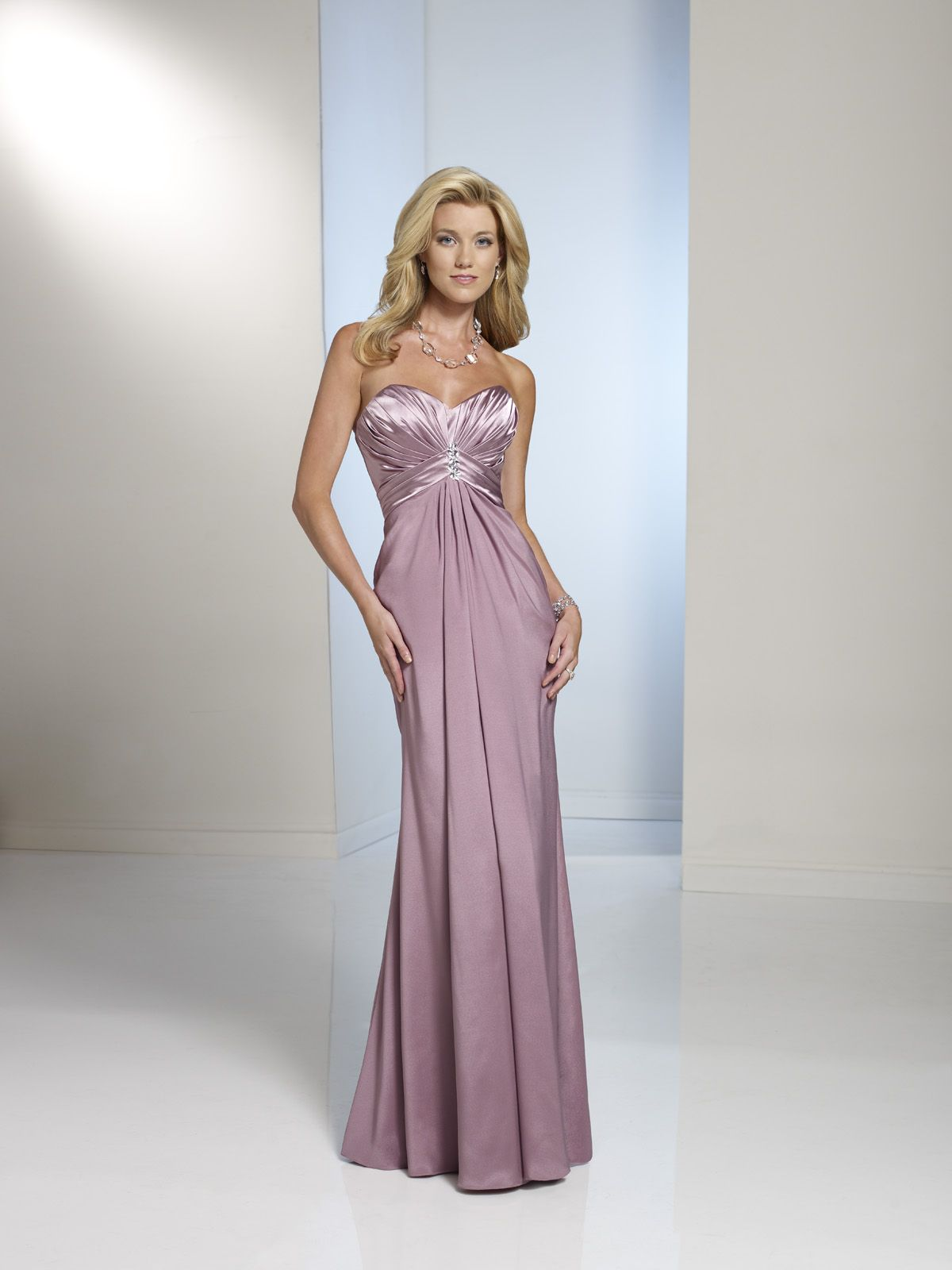 Wedding dresses with purple accents  Strapless crepe back satin gown with sweetheart neckline