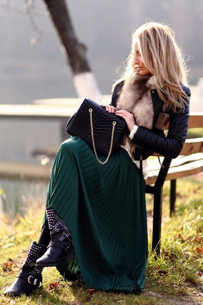 love this fall look. Deep emerald green maxi dress with black leggings underneath. Leather jacket and fur. Black quilted bag. Silver studded boots.