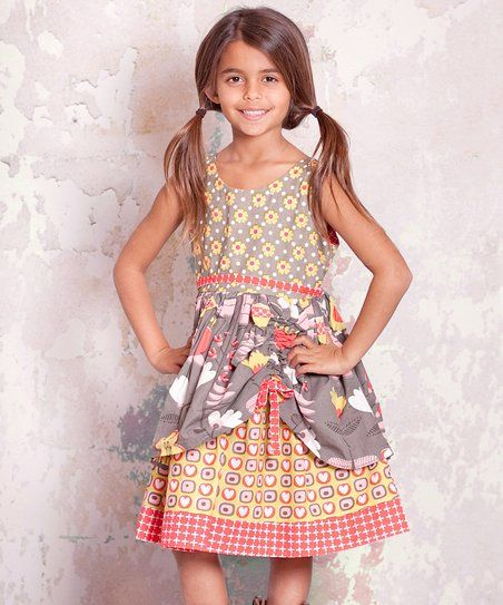 29e5235a9a6 With a darling mix of prints and elegant layered pick-up skirt