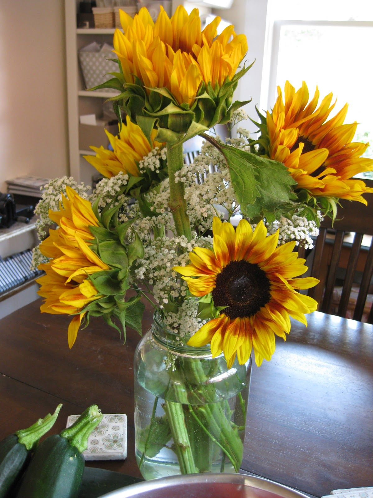 Sunflower in mason jar centerpieces love this