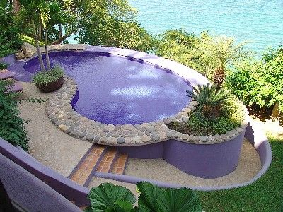 Contemporary kidney shaped above ground swimming pools for Contemporary above ground pools