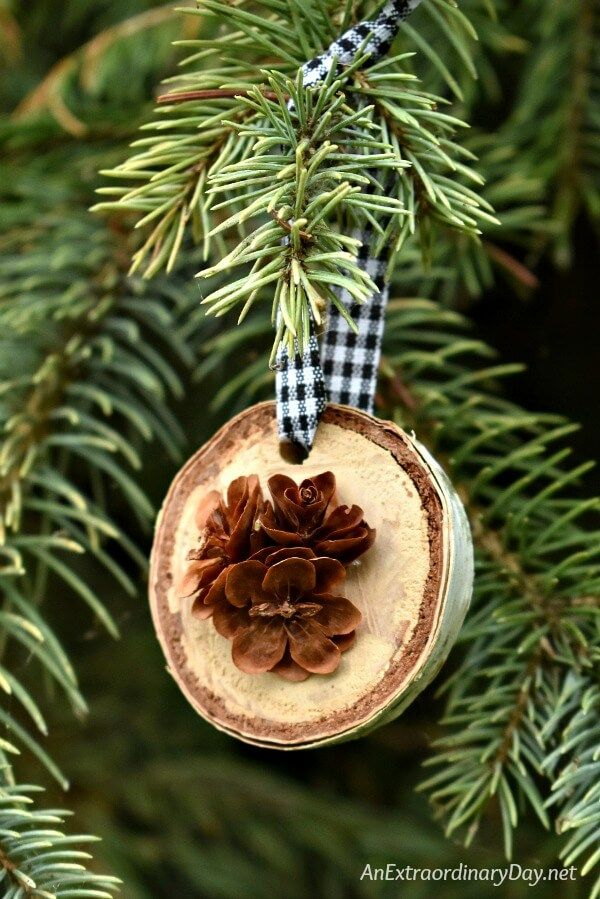 learn to make these simple rustic birch and pine cone christmas ornaments to decorate your tree great for gift giving too
