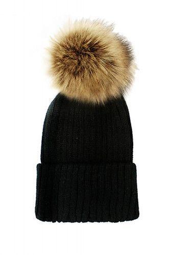 a0d0397ad94 Stretchy knit black beanie with large tan faux fox fur pom pom. 11