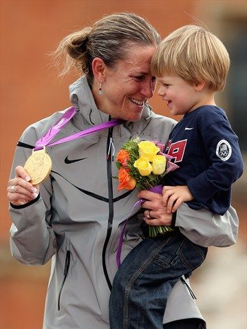 Gold medallist Kristin Armstrong of USA celebrates with her son