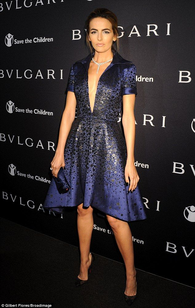 Super glam  Actress Camilla Belle donned a plunging midnight blue frock for  the Bvlgari and Save The Children pre-Oscar event on Tuesday 7b2c982b5