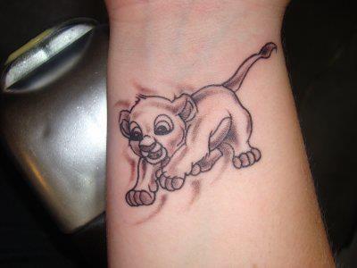 Disney tattoo. SIMBA OMGOSH.