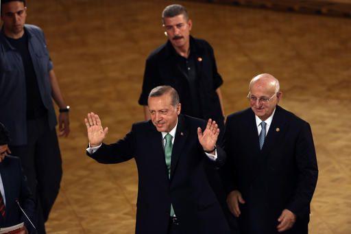 Turkey's President Recep Tayyip Erdogan salutes after his address at the parliament in Ankara, Turkey, Friday, July 22, 2016.   (AP Photo/Burhan Ozbilici)