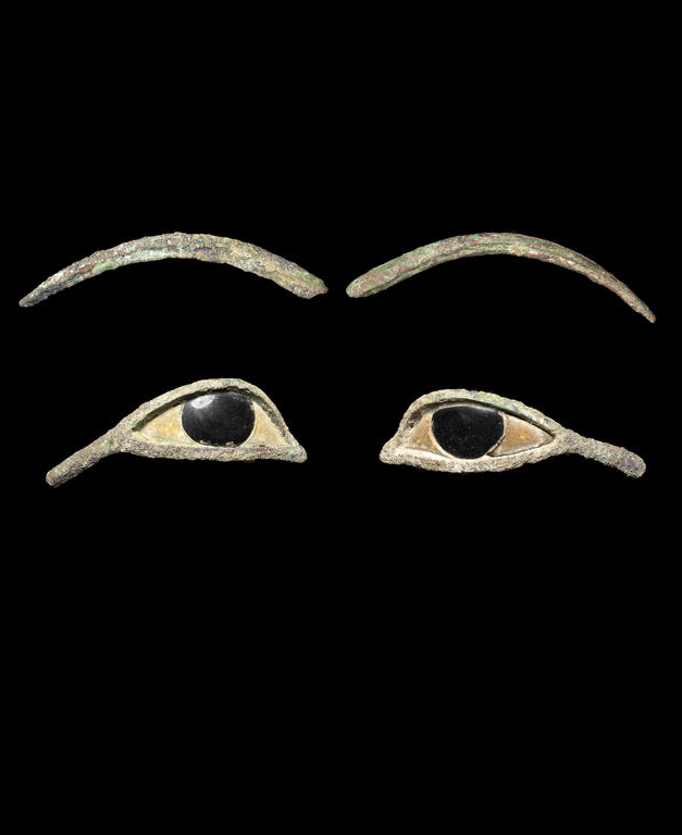 A pair of Egyptian bronze eye inlays. Late Period, circa 664-30 B.C.