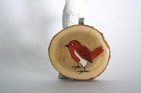 Amazing miniature artworks on natural wooden discs.