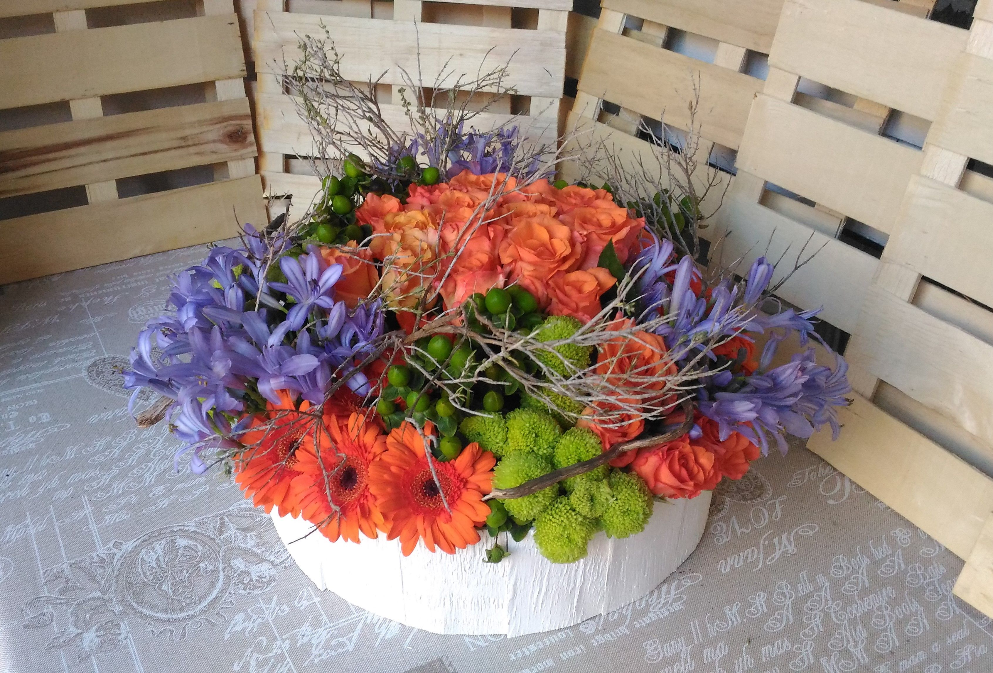 Orange centertable with blue agapanthus