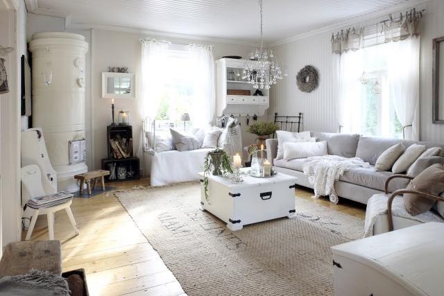 Pönttöuuni olohuoneessa  Unelmien Talo&Koti  sisustus