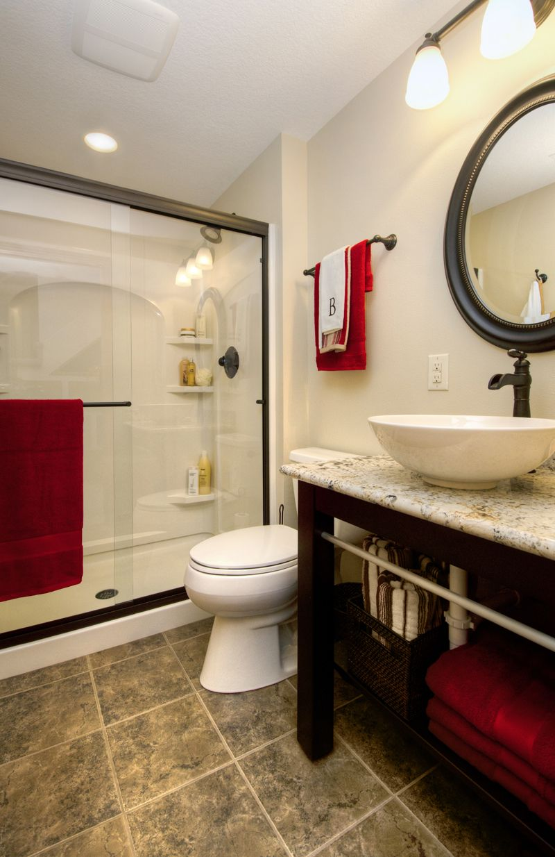 This beautiful basement bath serves guests as well as the family. The shower is encased with frameless shower doors that make the shower and entire room feel spacious. Kohler Wellworth two-piece toilet. Delicatus granite countertop with vessel sink basin. All fixtures are Delta Victorian series in Venetian Bronze.