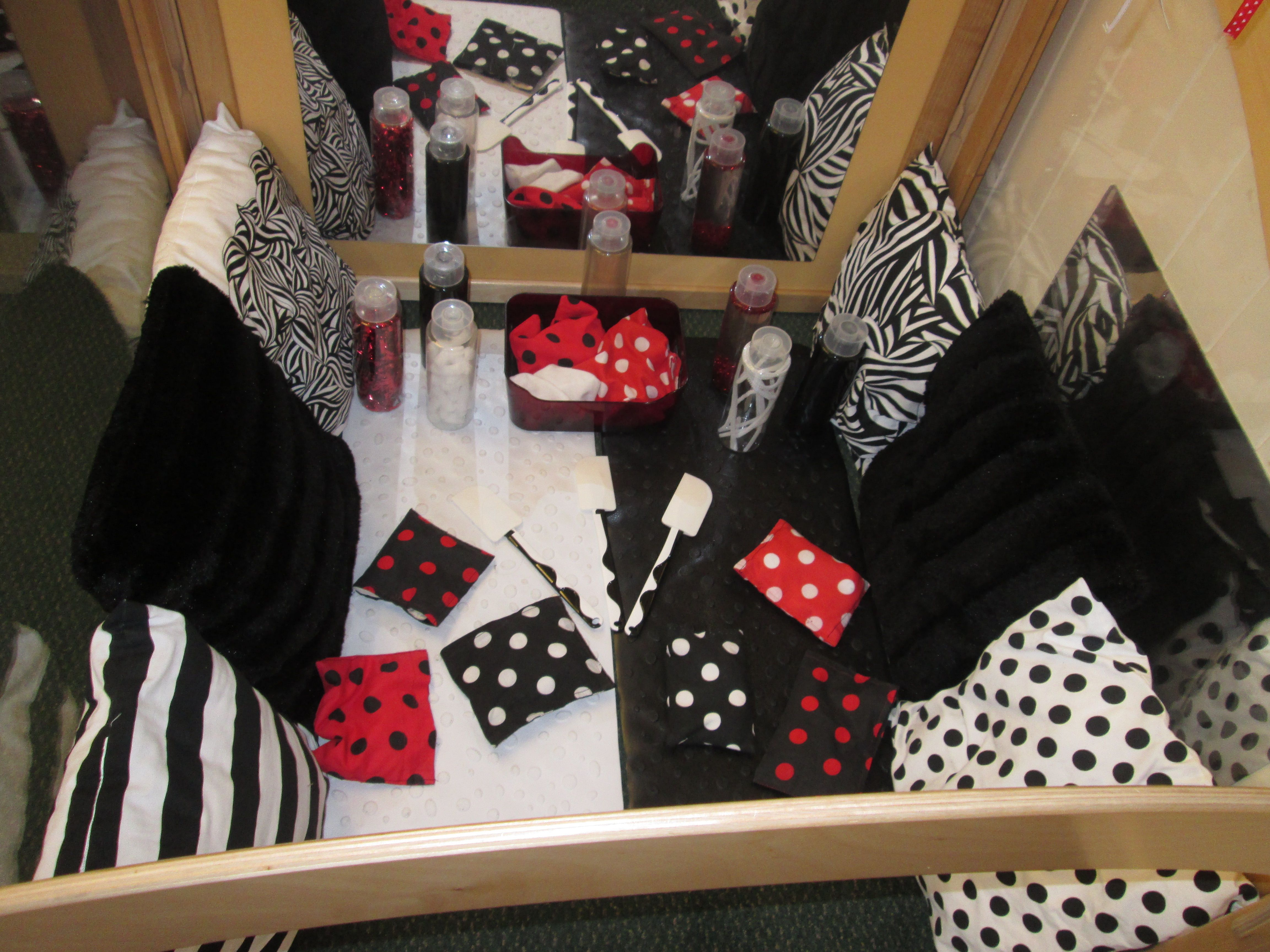 Black White And Red Area This Is Our Cube That The Younger Babies Have Access To We Have Created A Ran Baby Room Activities Baby Sensory Board Baby Sensory