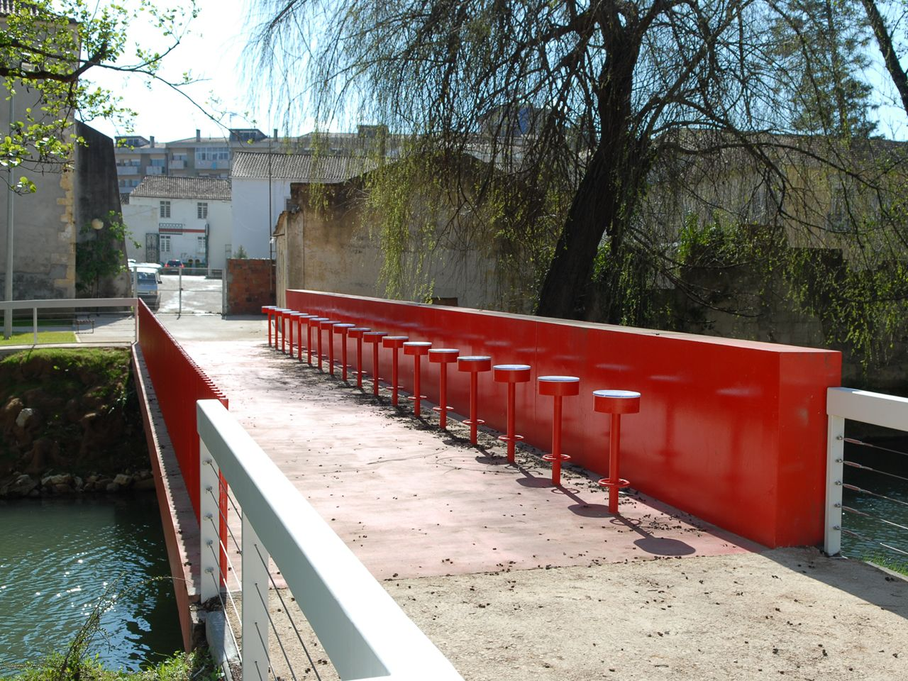 Rotterdam-based MVRDV designed a suite of themed pedestrian bridges for the city of Leira in central Portugal, including the Bar Bridge shown here.