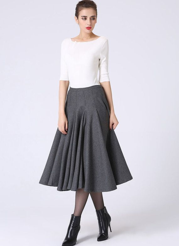 1b4322530 A gorgeous pleated skirt in gray. This is the perfect piece for your  wardrobe. It will literally match everything you own! Just add boots and a  sweater to ...
