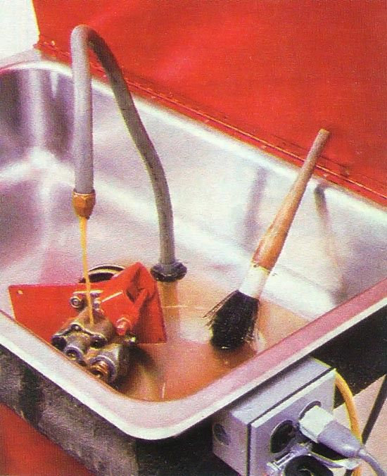 Parts Washer by Mother Earth News -- Homemade parts washer constructed from a surplus sink, drainpipe, 30-gallon drum, sheetmetal lid, submersible pump,  http://www.homemadetools.net/homemade-parts-washer-47