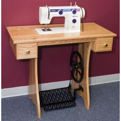 Modern Treadle Sewing Machine With 13 Built In Stitches. Can Also Be Used  With Electricity