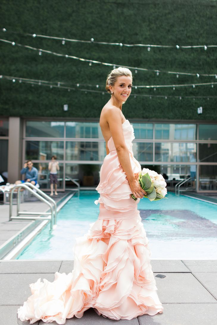 Stunning blush pink wedding gown ruffles pink details