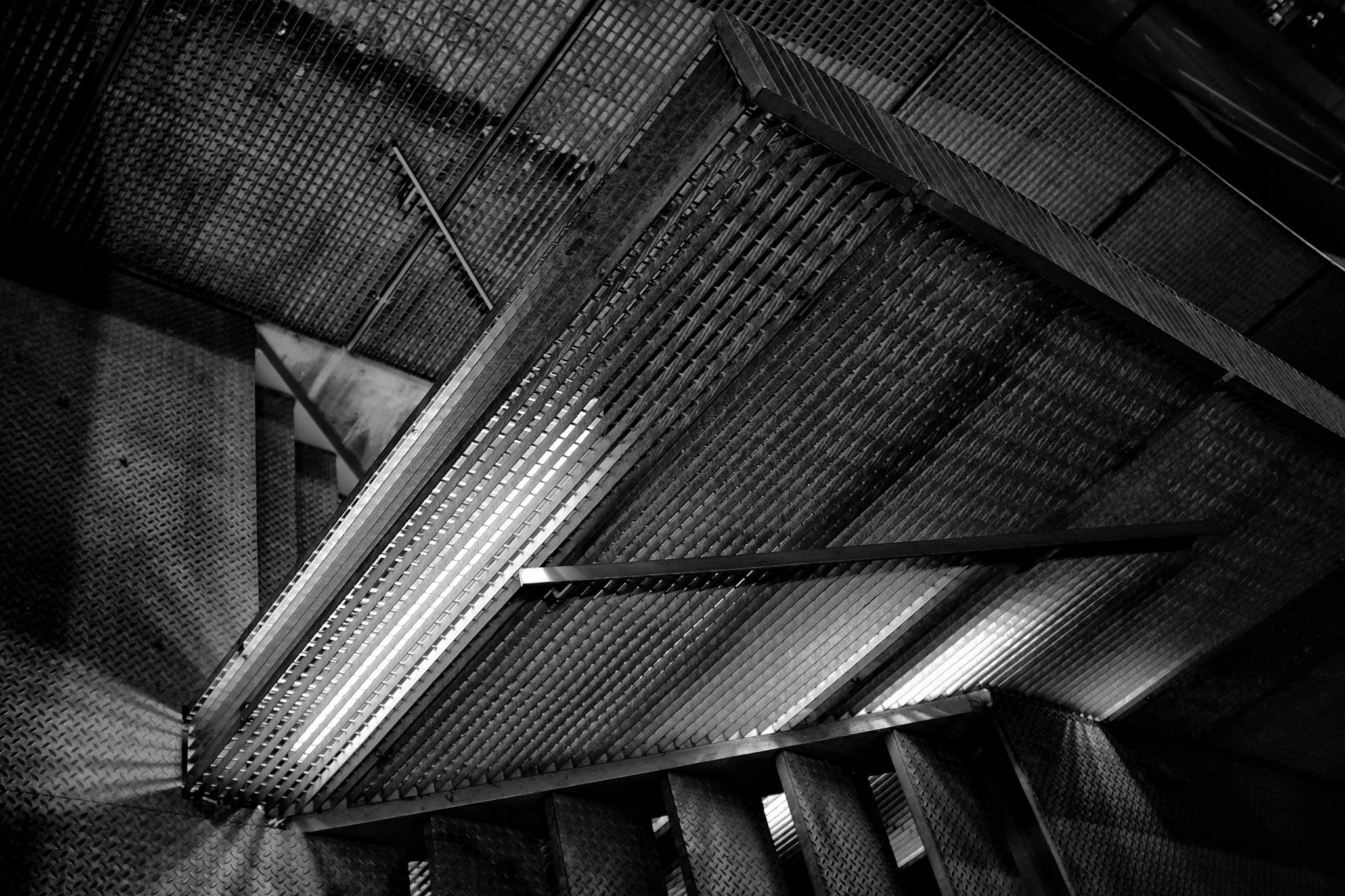 Steps into the guts of a subterranean parking lot may be sexy. At night, of course. :)