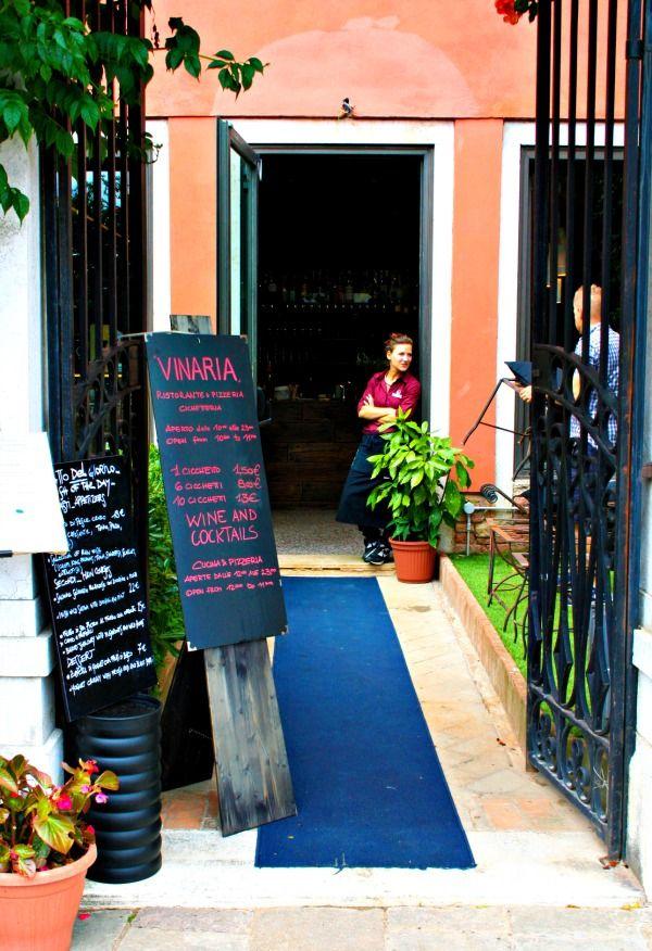 VENICE, ITALY-Cozy vinaria or wine garden next by the Rialto Bridge
