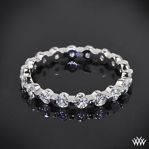 Hearts and Arrows Diamonds Custom Diamond Wedding Ring is set in