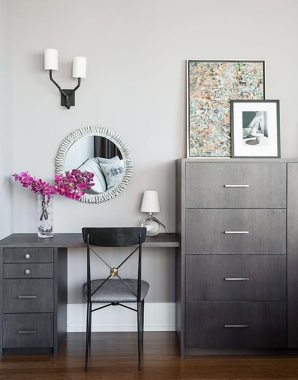 Chic Bedroom Boasts A Gray Wash Make Up Vanity And Desk Combo Paired With Black Gold Chair Placed Under Silver Sunburst Mirror Next To Tall