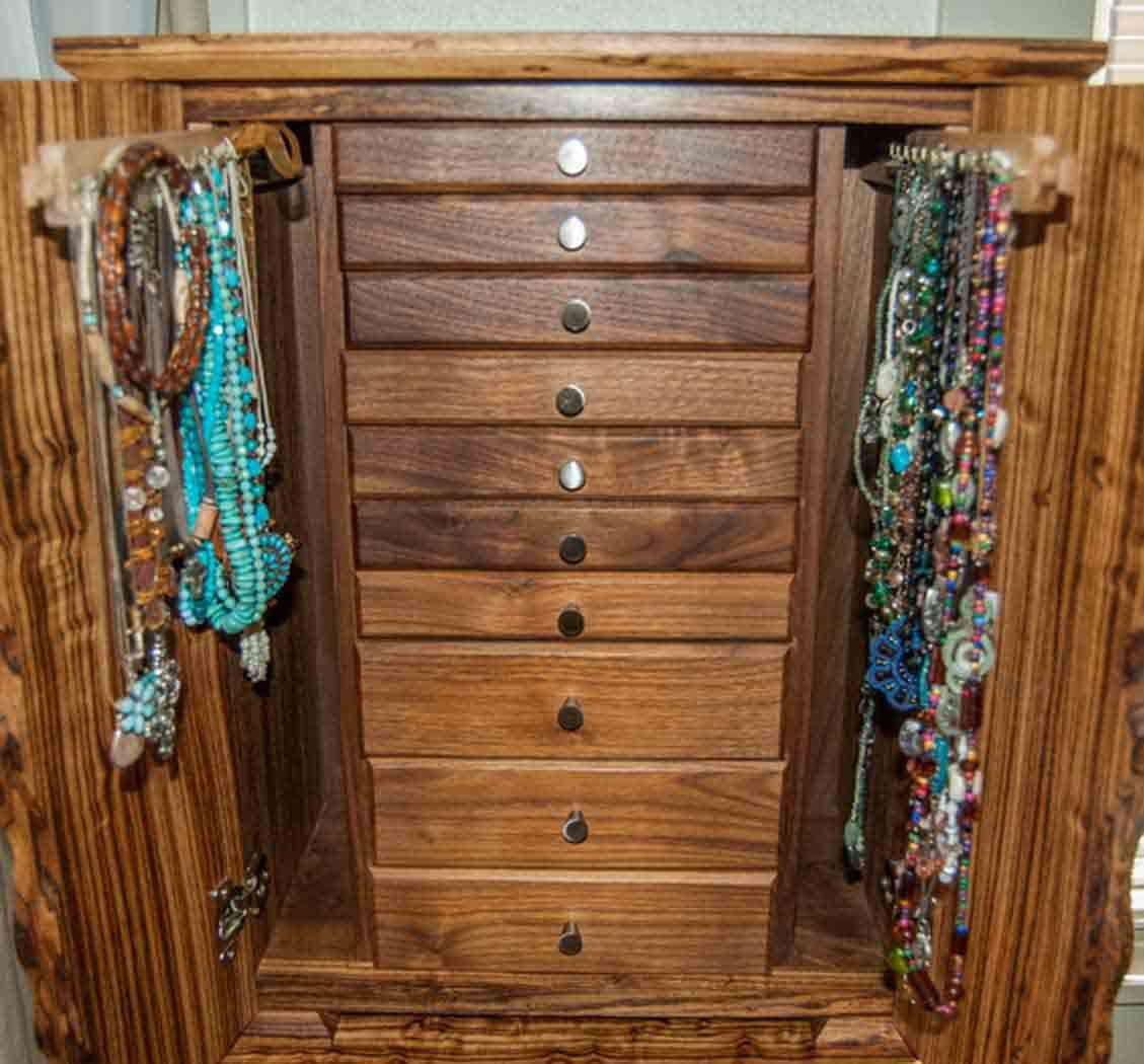 This gorgeous necklace jewelry box stores dozens of necklaces while