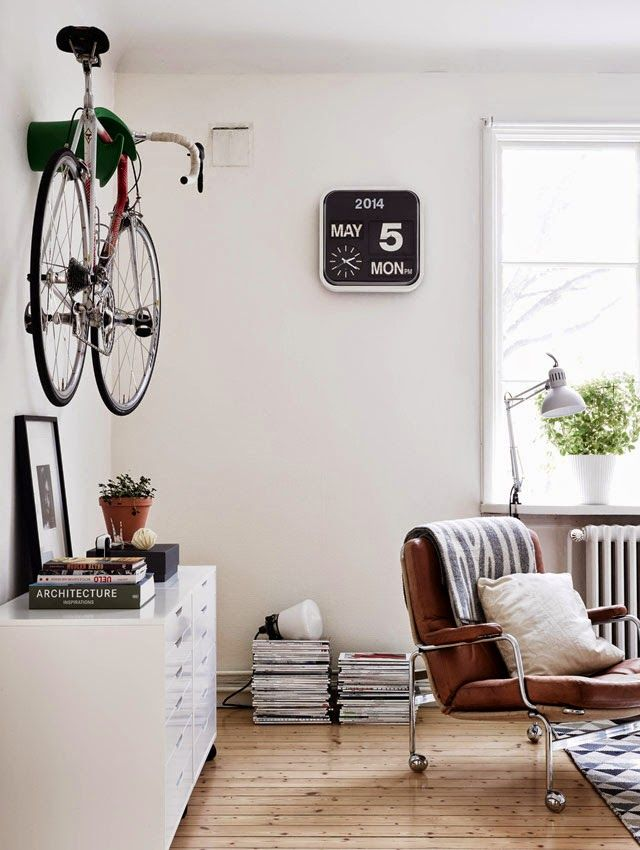 A Cery Good Looking Room Notice The Bike Hanged On The Wall The Beautiful Black And White Clock With The Date With Images House Interior Home Living Room Minimalist Home
