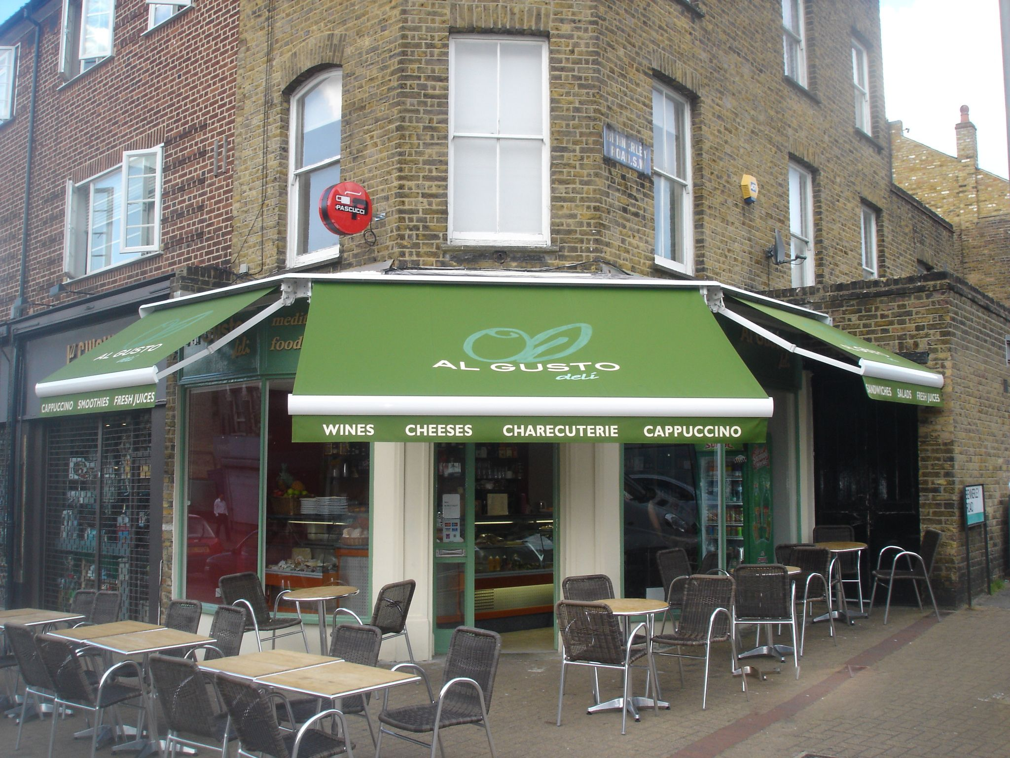 3 Retractable Awnings What Made A Restaurant Times Bigger Nicely Covered With Green Canvas