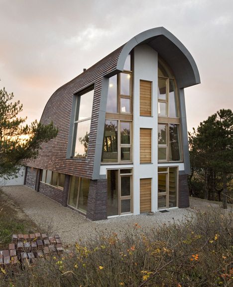 This Dutch House Features Exposed Tree Trunk Columns Inside