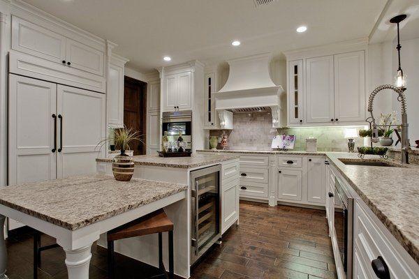 Mediterranean Kitchen Giallo Ornamental Granite Countertop White Cabinets  Wood Flooring Kitchen Island