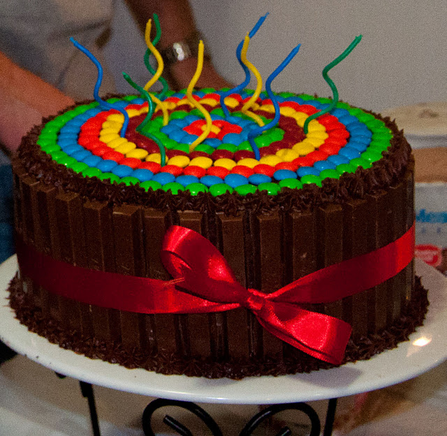 It S A Candy Cake A Regular Cake With Kit Kats Around The Edge