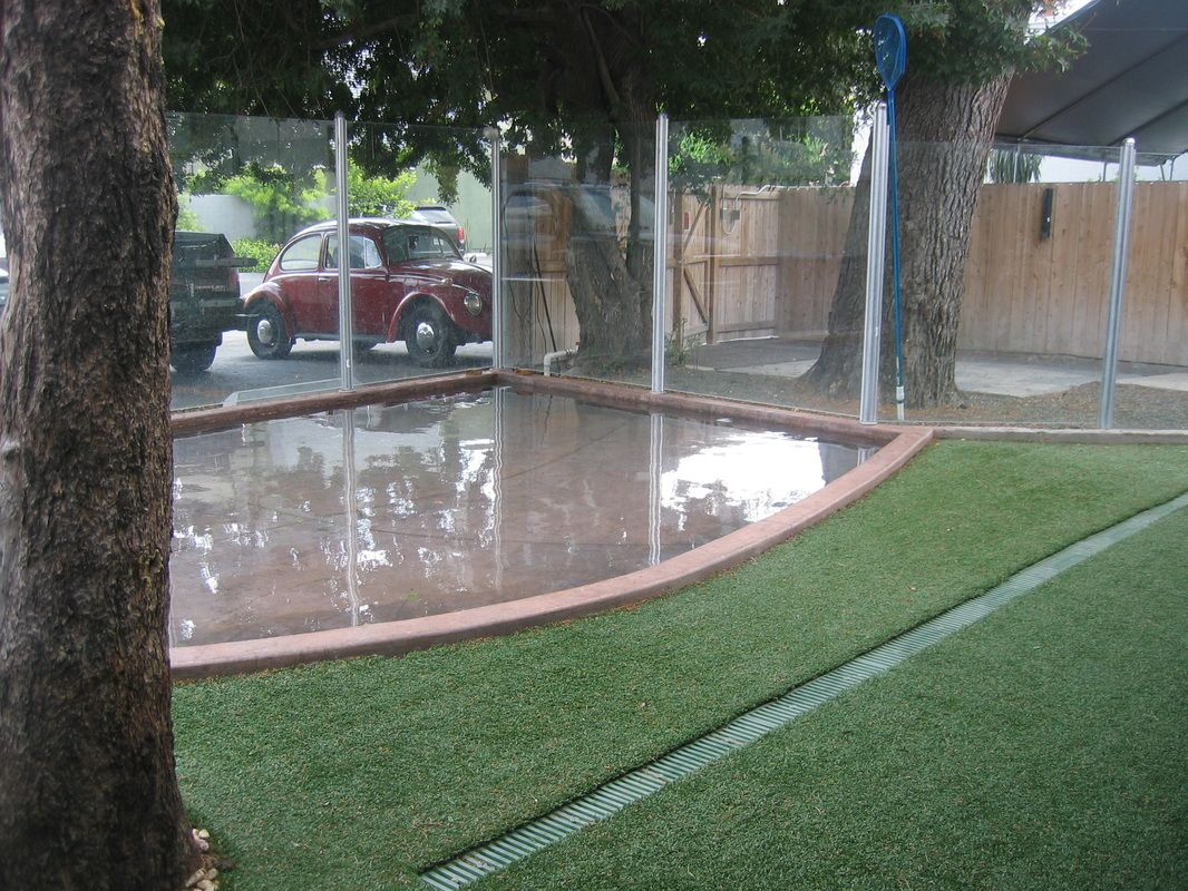 nice dog yard with cement for messy days and turf to eliminate mud