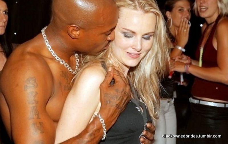 White women with black men flirting, drinking and dancing ...