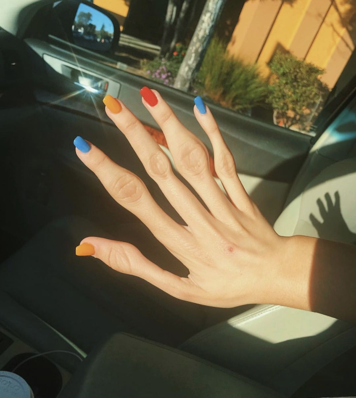 Emma Chamberlain S Yellow Red And Blue Acrylic Nails Acrylic Nails Yellow Blue Acrylic Nails 90s Nails