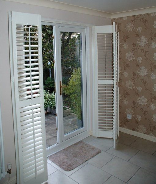 Patio door shutters these plantation shutters are of the for Wood doors and shutters