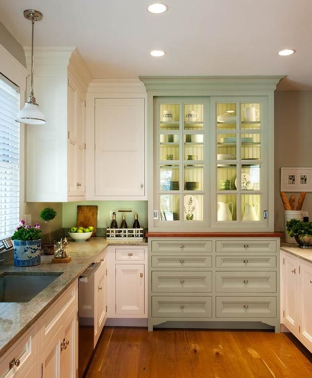 Country kitchen with integrated kitchen hutch with glass for Brushed sage kitchen cabinets