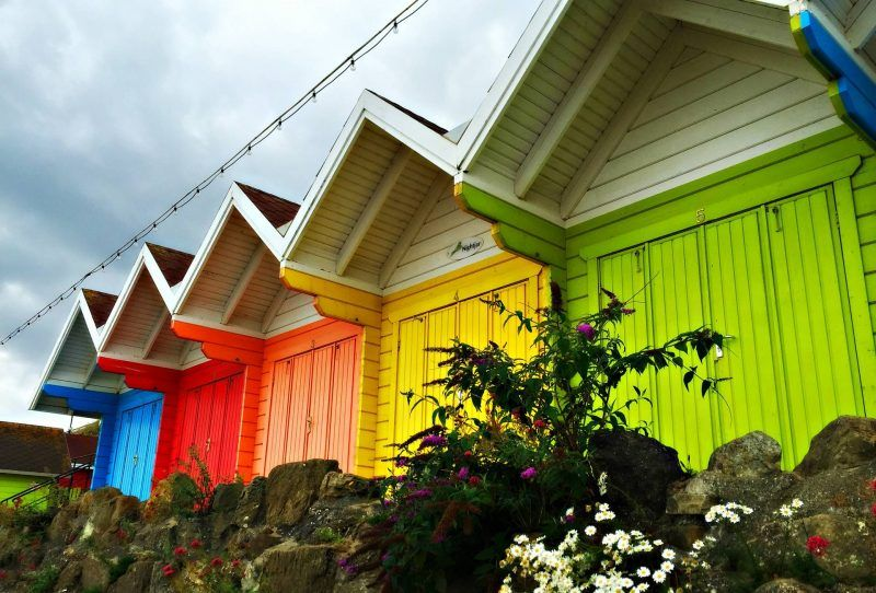 brightly coloured beach huts at Scarborough