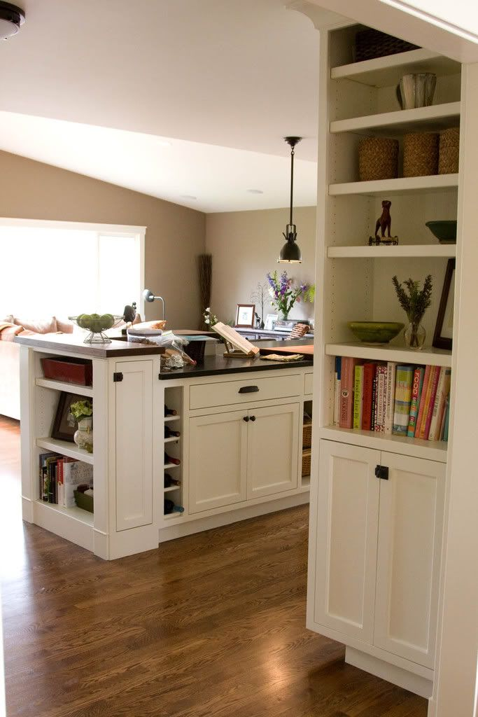 Love the extra shelves on the sides of cabinets as you ...