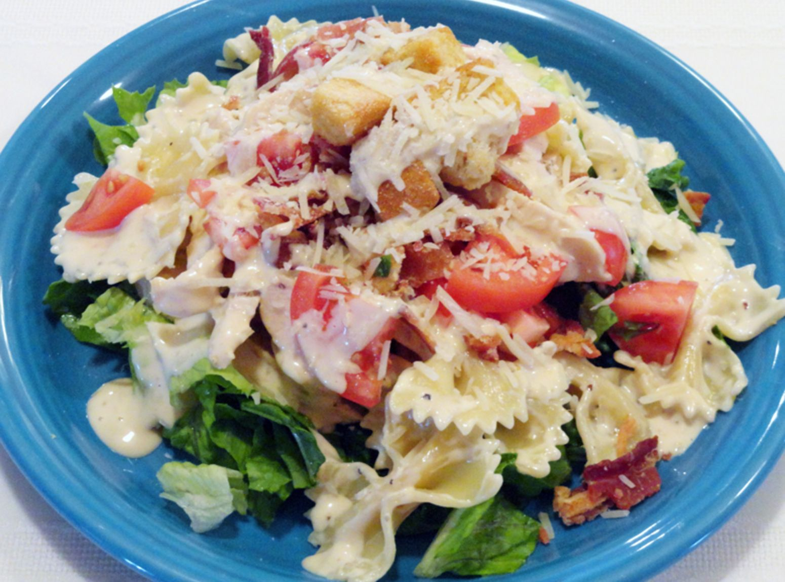 Chicken Caesar Pasta Salad - recipe from Just A Pinch cook Fran Miller - get yourself over to this site and enjoy all the fabulous recipes.  You will surely become lost in the drool worthy recipes.  Ollie B