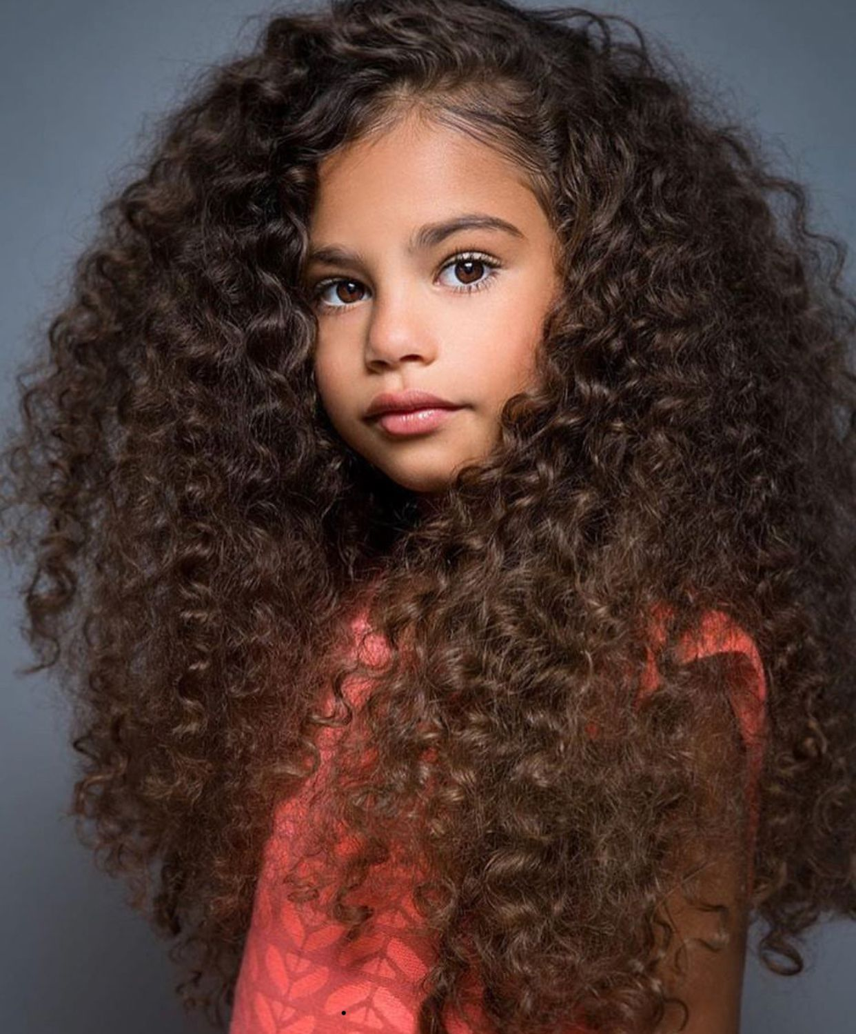 Mixed Pretty girl with curly hair