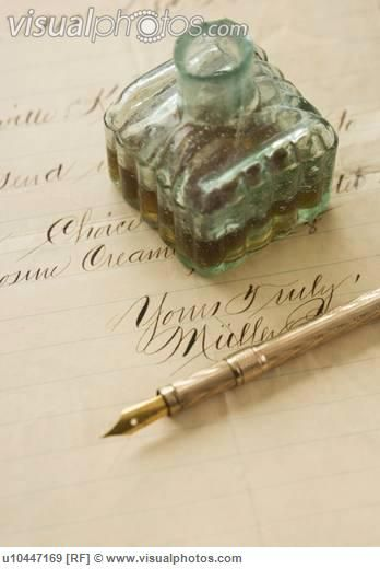 Quill pen and ink bottle on old letter perhaps was used to write the sweetest of love letters