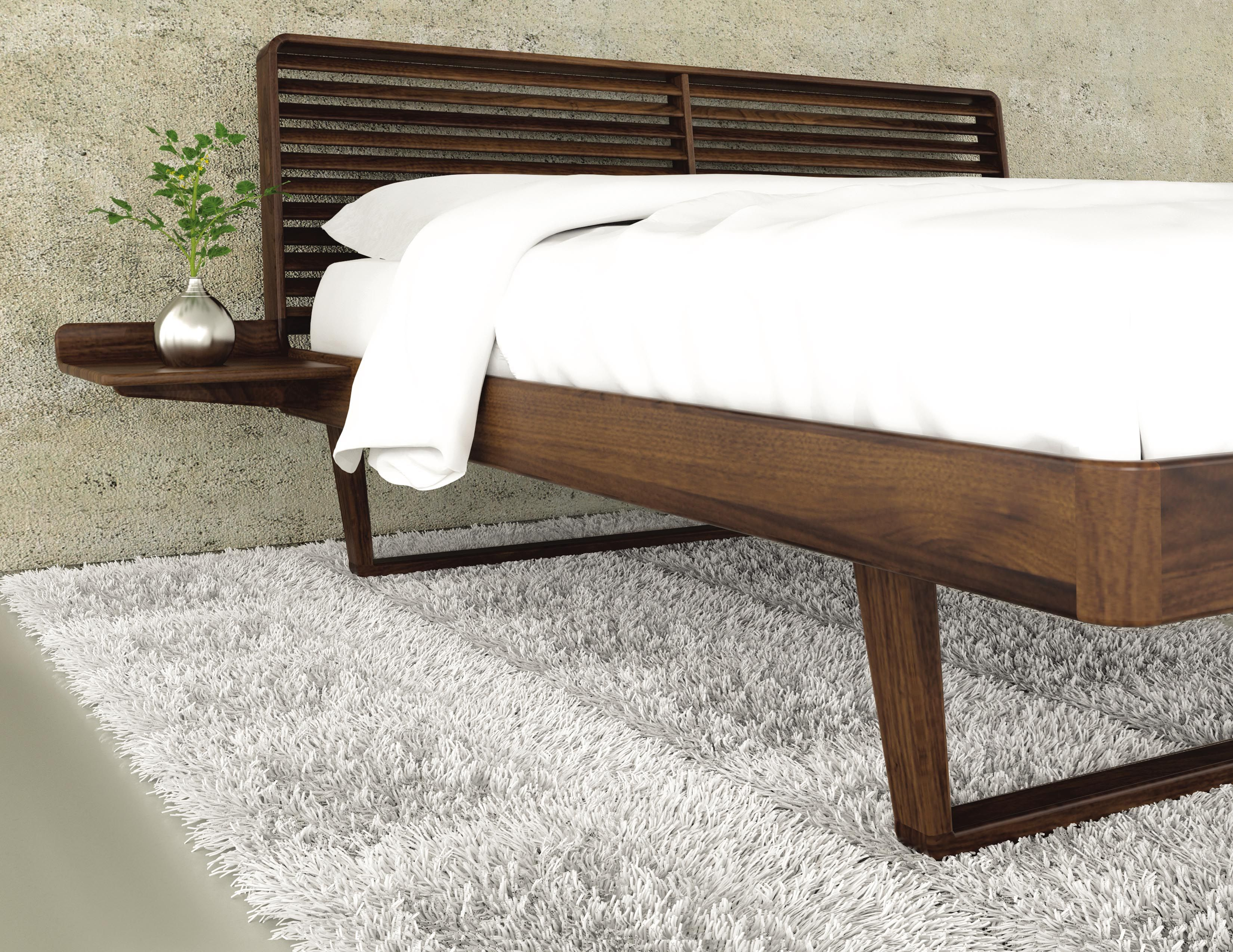 Major space saver a bed with built in nightstands! A