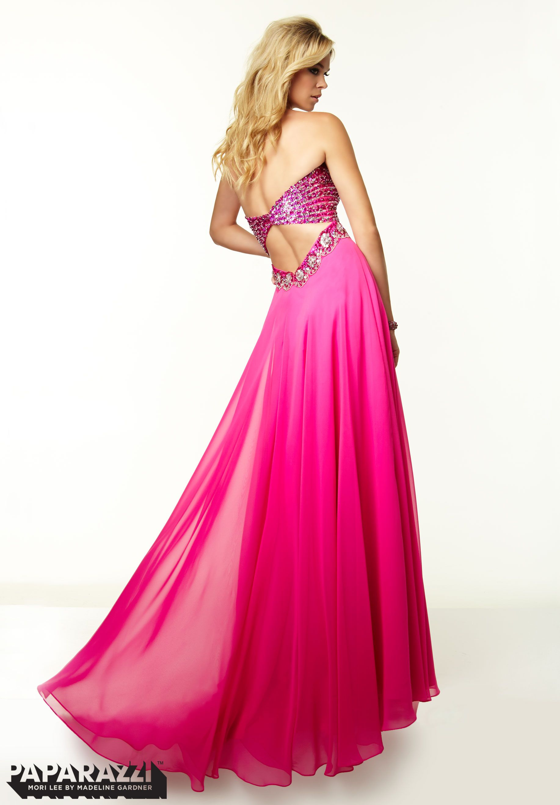 We love the sexy back on this flowing #hotpinkpromdress from ...