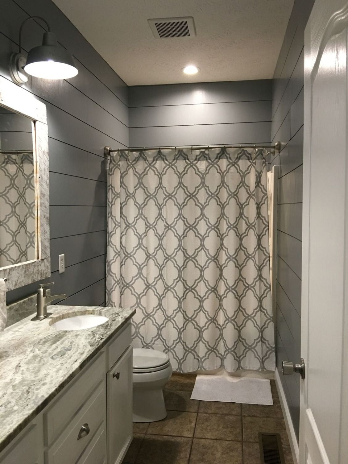 For a twist on a classic consider gray shiplap in the for Bathroom remodel 85382