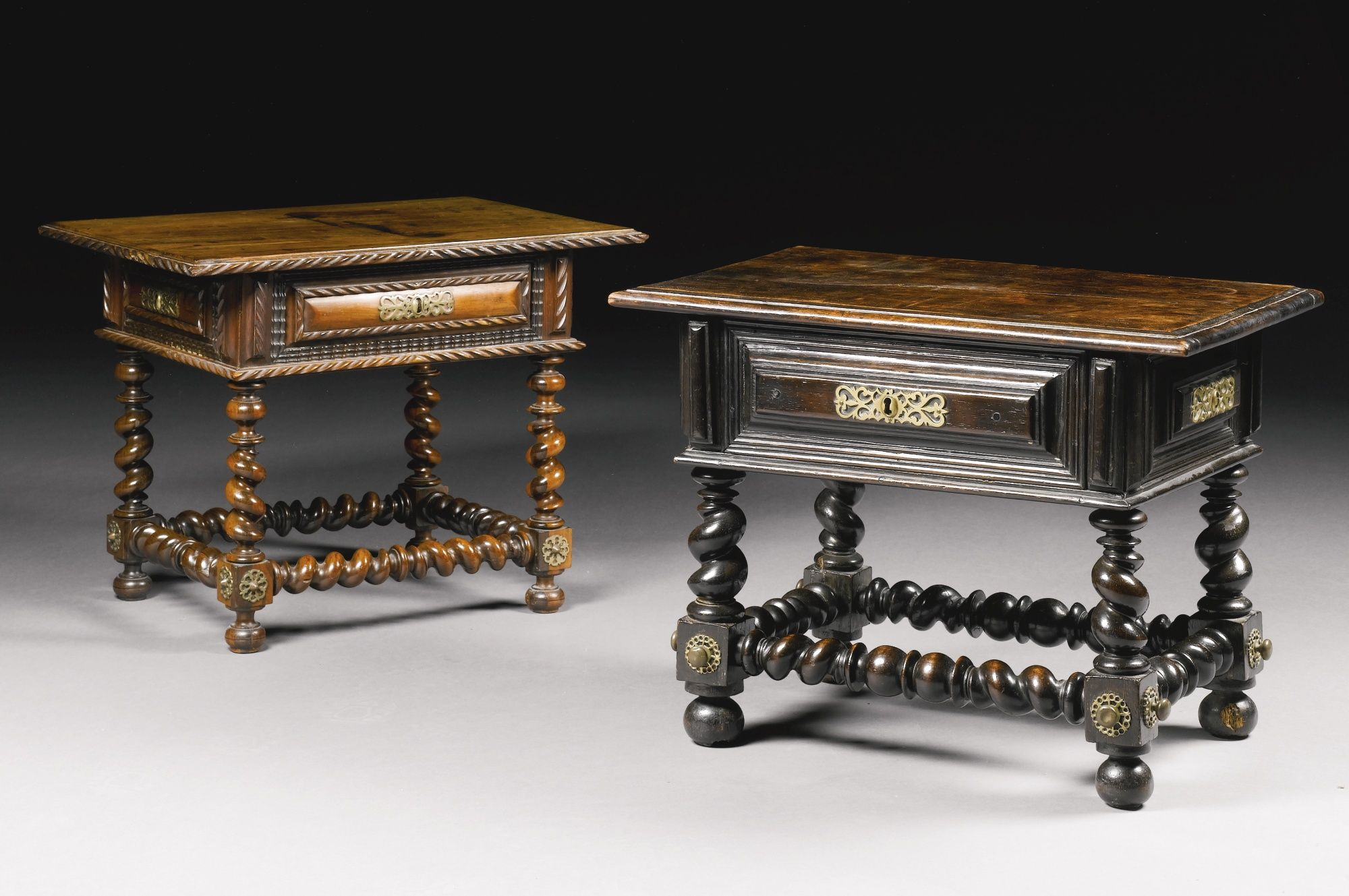 A Portuguese brass-mounted rosewood low table, early 18th century the rectangular top with moulded edge above a cushion frieze drawer, with dummy drawers to the reverse and sides, supported on ring-turned legs joined by conforming peripheral stretcher