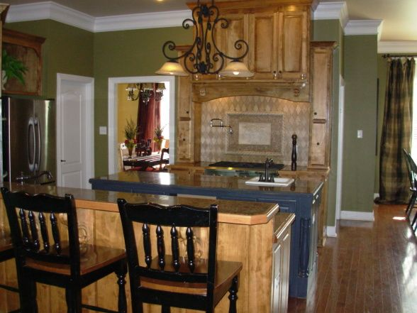 Olive green kitchen colors photo video 631075309 medium for Green paint for kitchen walls